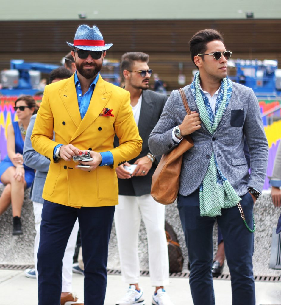 2 dapper gentlement wearing colorful suits