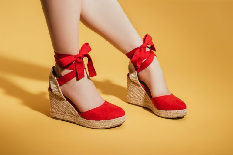 tight shot of red espadrille shoes on caucasian female legs